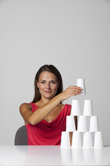 Woman with white paper cups