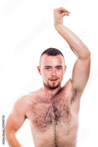 Shirtless hairy man posing