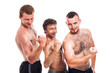 Shirtless sportsmen posing