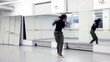 Black woman dancing, in studio