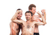 Happy shirtless sportsmen posing