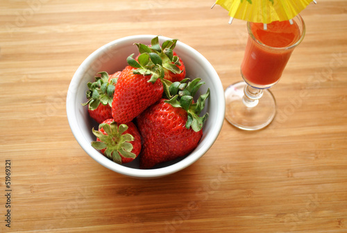 Bowl of Strawberries with a Small Cocktail