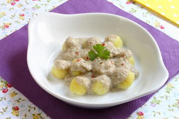 Ñoquis con salsa de champiñones