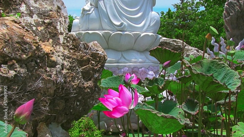 Buddha and lotus on blue sky background