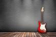 Raum mit Holzboden, Ziegelwand und E-Gitarre rot