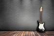 Raum mit Holzboden, Ziegelwand und E-Gitarre schwarz