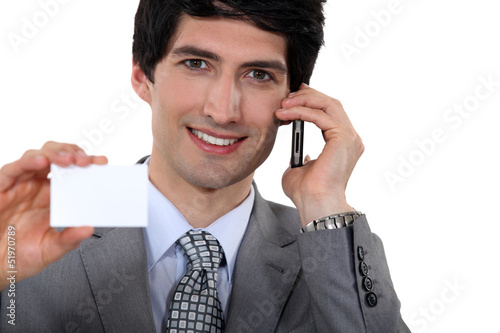 Executive holding a blank business card