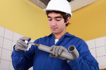 portrait of a young plumber