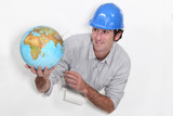 Construction worker holding a globe