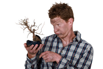 Electrocuted man holding a plant