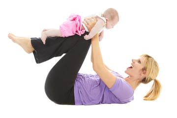 young beautiful caucasion mom doing baby yoga