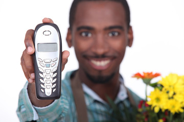 Florist holding telephone