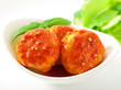 meatballs in tomato sauce, decorated with leaves of basil