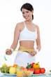 Sporty woman measuring waist