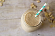 Smoothie in mason jar with aqua blue straw - 51974789