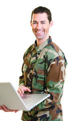 White male in army uniform on lap top smiling