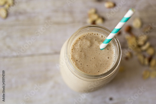 Smoothie in mason jar with aqua blue straw