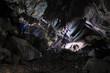 2 Caver in a cave, Pugnetto, Mezzenile, Piedmont, Italy
