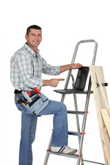 Builder with wood and a laptop