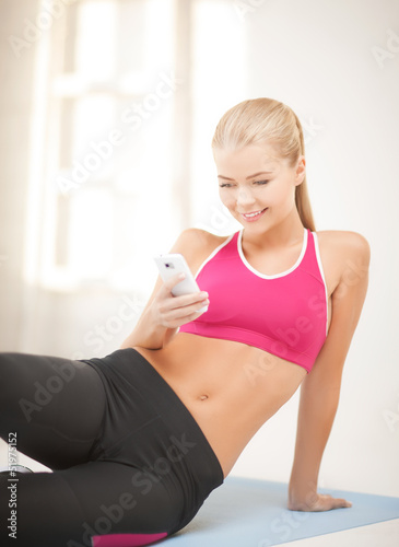 woman sitting on the floor with smartphone
