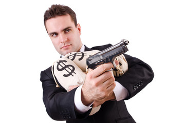 Man with gun and sacks of money