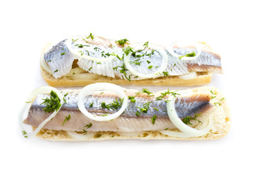 Sandwiches with herring, onions and herbs, isolated