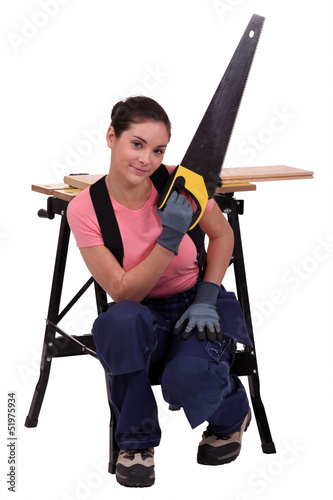 Woman with hand-saw