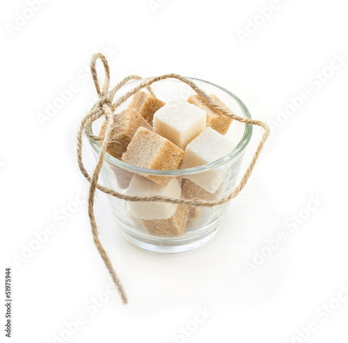 Sugar cubes in glass  bowl on white background