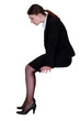 businesswoman sitting in profile with legs dangling