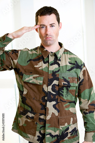 White male in army uniform saluting