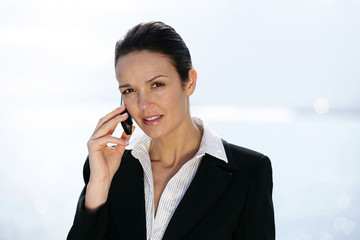 Businesswoman outdoors on a cellphone