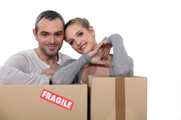 Couple stood with storage boxes