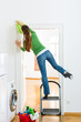 Woman at the spring cleaning working dangerously