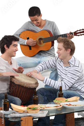 Three friends playing musical instruments