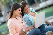 Friends using a laptop