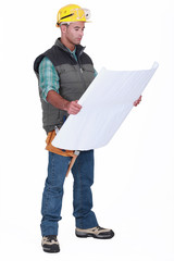 A foreman checking blueprints.