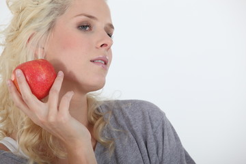 Attractive blond holding red apple
