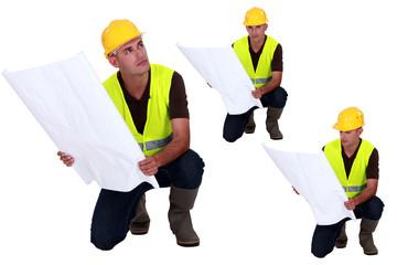 Multiple shot on foreman with plans kneeling