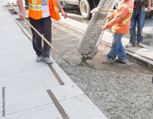 Pouring cement for new sidewalk