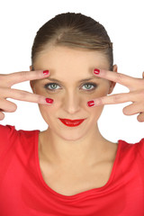 Woman holding her fingers around her eyes
