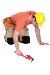 Workman with an adjustable wrench