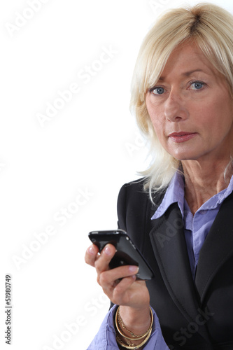 Mature businesswoman with a cellphone