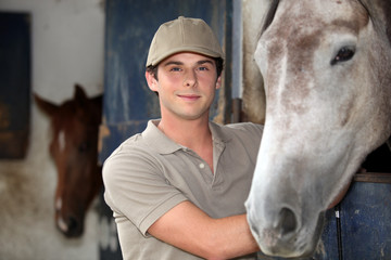 Teen in equestrian center