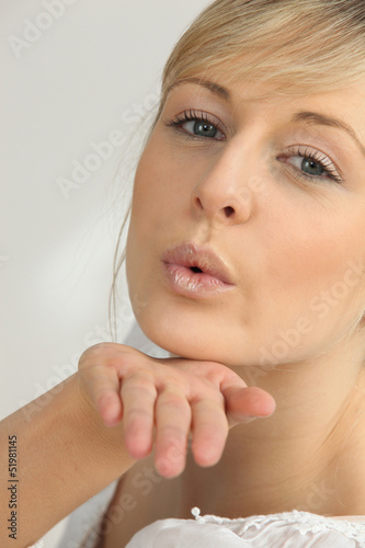 Blond girl blowing kisses