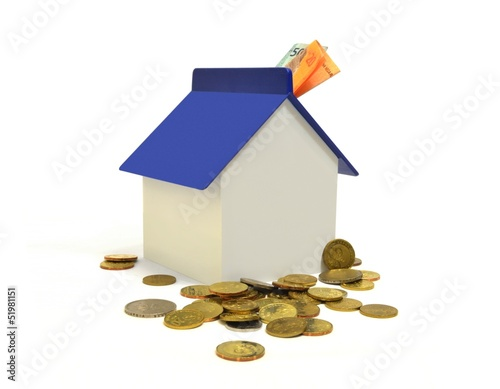 House and coins, property investment concept