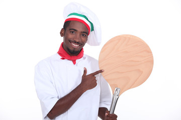Pizza chef showing his pizza loading peel