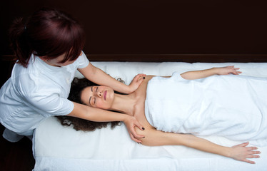 woman having chiropractick neck adjustment
