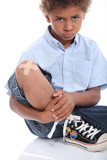 Child with bandage on the knee