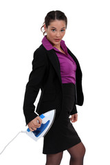 Businesswoman stood with iron