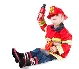 Funny boy in fireman costume with a helmet to go off the side